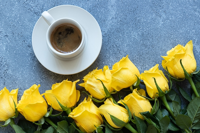 Coffee and yellow roses